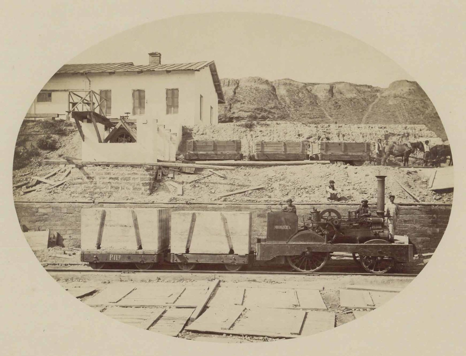 Паровоз «Молодец» и две вагонетки