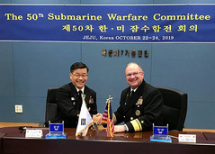 Rear Adm. Jimmy Pitts and  Rear Adm. Jung Il Shik pause for a photo during the 50th semiannual Submarine Warfare Committee Meeting (SWCM).  (U.S. Navy/Lt. Gregory Pavone)