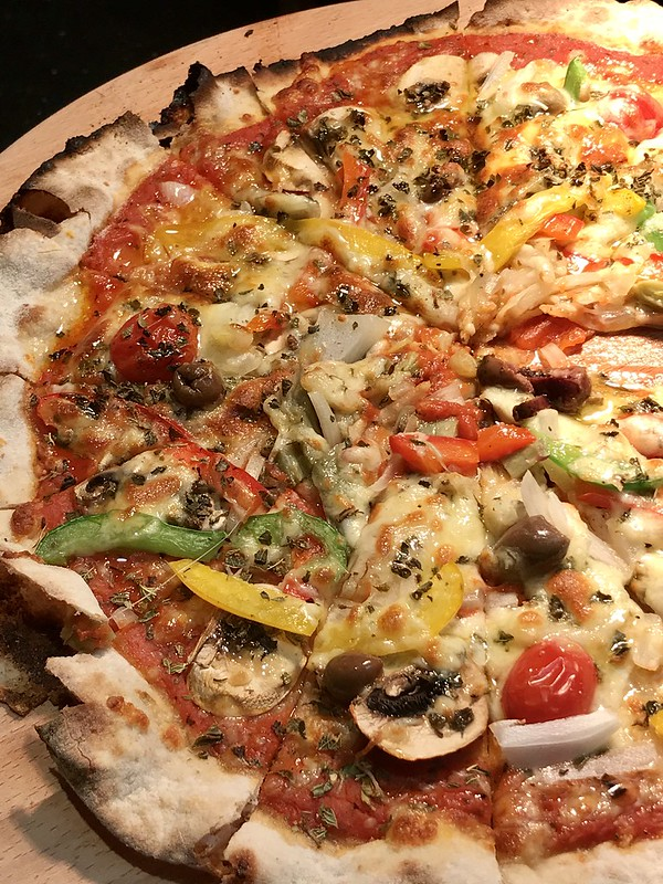 Vegetarian Pizza: Tomatoes, Mushrooms, Artichokes, Onions, Capsicum, Olives, Mozzarella