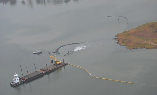 Aerial photo of boat dredging a river
