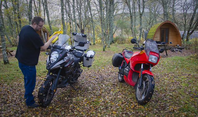 Egor cleans his VStrom on Cannich Campsite