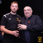 Goalscorer Kai Ross is presented with his Man of the Man award by Alan Smith