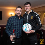 Glenn Murison (right) is presented with his man of the match award from WM Stuart