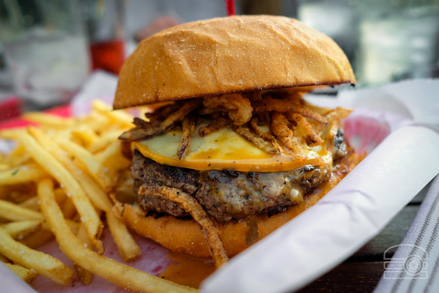 Burger w/ Carolina BBQ Sauce, Smoked Gouda, Smoked Peaches, Onion Straws - Table 9