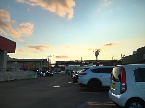 30october2019 edited kitahiroshima hokkaido japan dusk train parkinglot sunset clouds cars