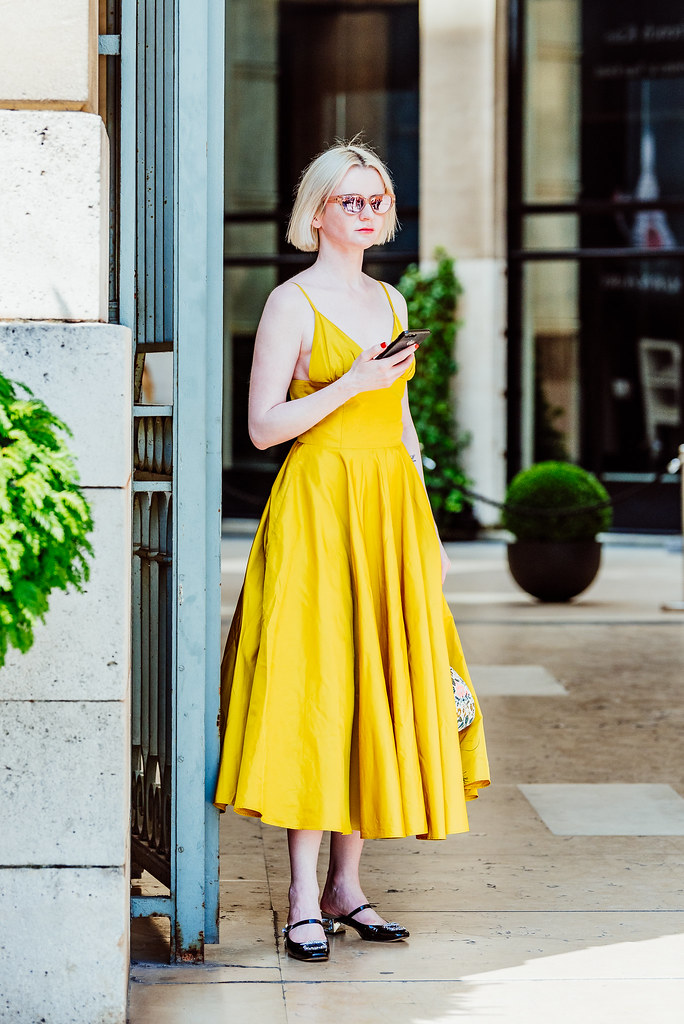 A blond woman in yellow dress