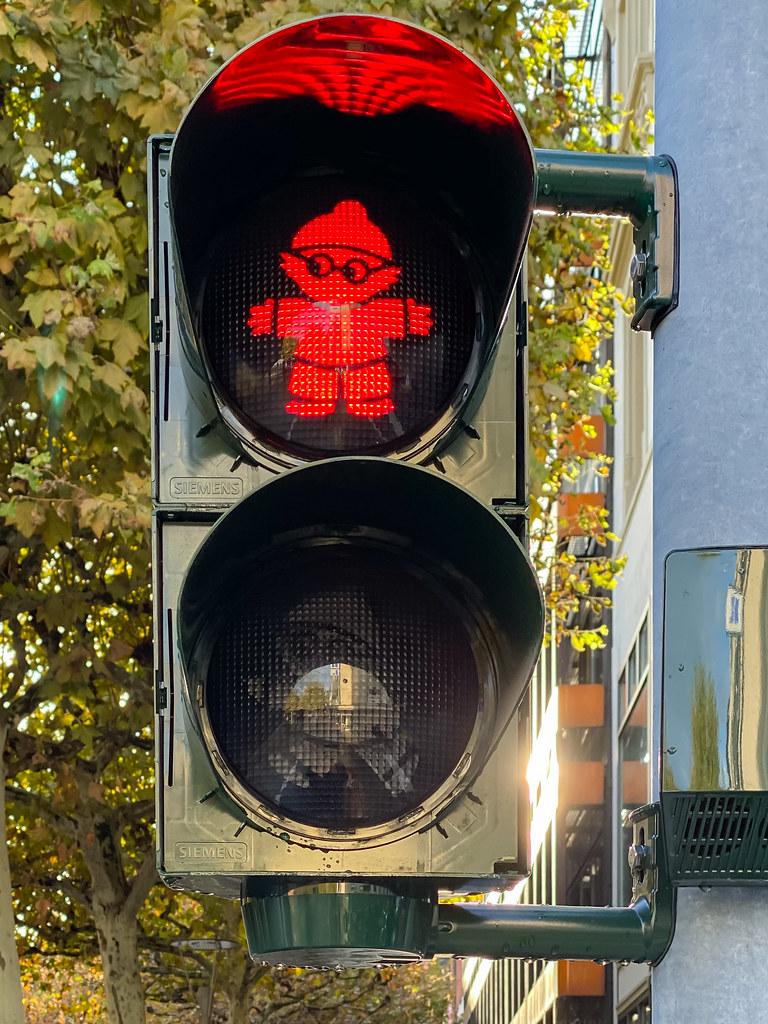 Red Mainzelmännchen traffic light in Mainz, Germany