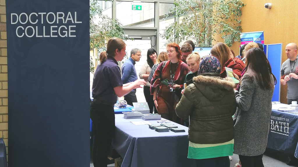 students visiting stands at the Doctoral Information Fair