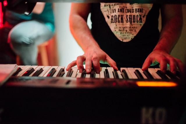 Close up of keyboardist on stage during a live concert