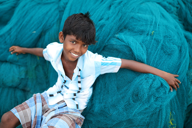 India, young boy on a fishing net