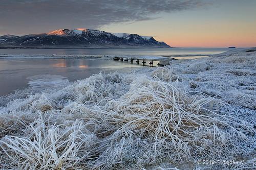 friðþjófurm canon5div canonef1740 winter frozenwater river bridge skagafjörður skagafjordur norðvesturland northwesternregion tindastóll drangey iceland ísland sunset clouds landscape seascape