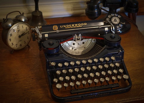 1928 Underwood Four Bank Portable Typewriter and Western Electric Telephone