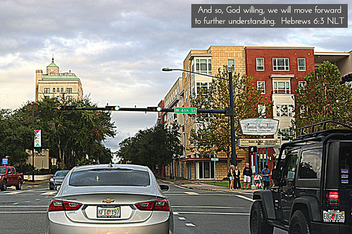 light downtown gainesville stoplight road street city urban building cars skyline skyscraper buildings streetlight intersection greenlight streetcorner avenue hdr travel usa america landscape us cityscape christ unitedstates florida god jesus lord fl fla alachuacounty bible scripture verse