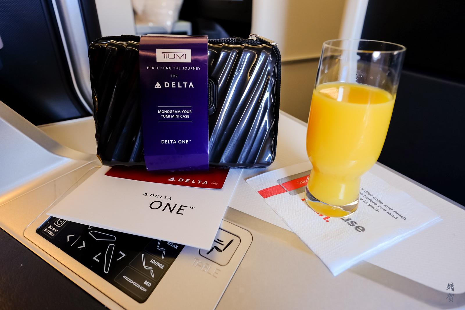 Tumi amenity kit and pre-departure beverage