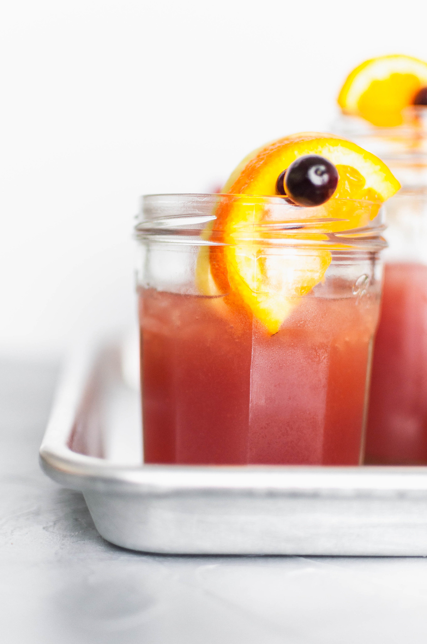 This Thanksgiving Punch is the perfect festive drink to serve on Thanksgiving. Cranberry juice, orange juice, apple cider and ginger beer create a deliciously addictive punch. Spiced rum optional.