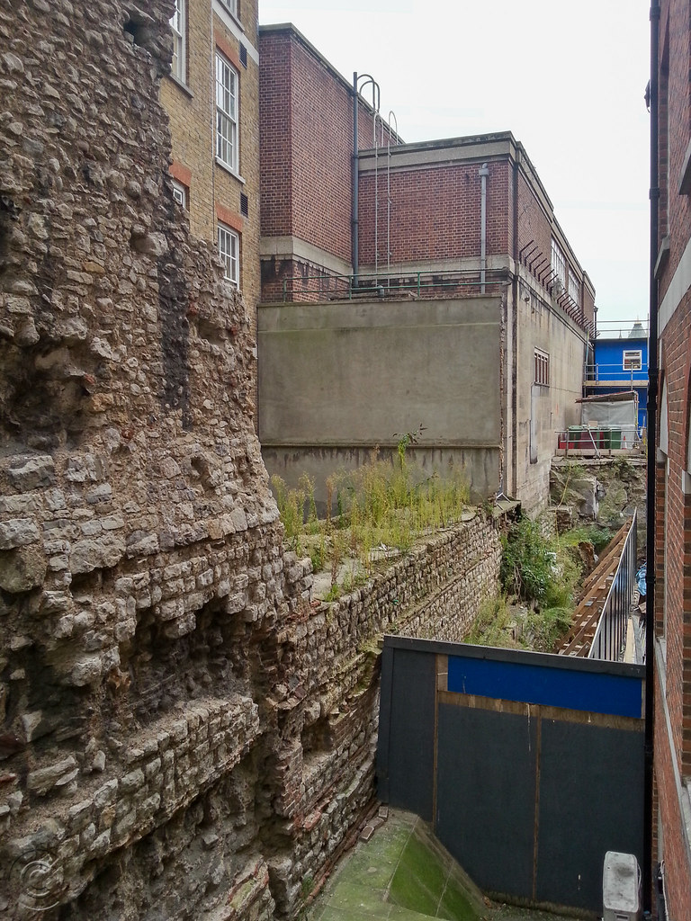 Looking south from Cooper's Row, the western inner face of the Roman Wall continues towards Tower Hill tube station.