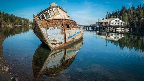 shipwreck lakebay washingtonstate washington bay reflection boat pier richborder rich border sonya7riii blue decay abandoned derelict demise