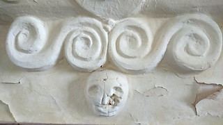 plaster scrolls and skull (17th Century)