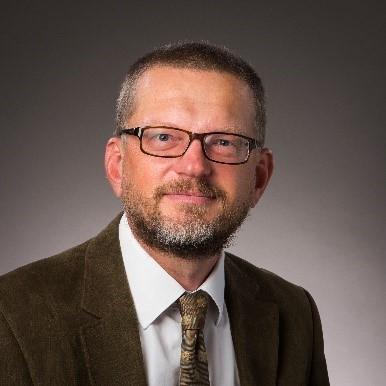 Head shot of Professor Chris Brace