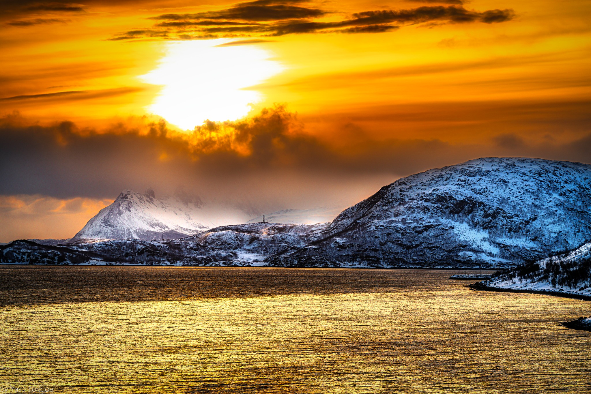 View of sunrise behind the mountain on Kågen island, Norway while sailing between Arnøya and Kågen Islands-15a