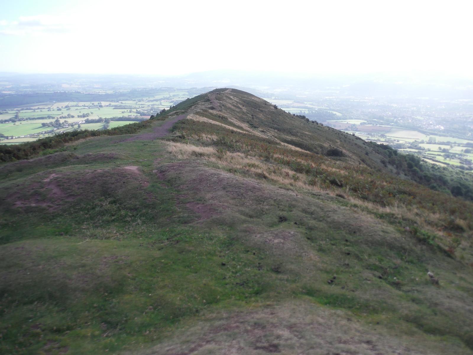 Signs of Iron Age Hillfort site, top of The Skirrid SWC Walk 347 - Llanvihangel Crucorney Circular (via Bryn Arw and The Skirrid)