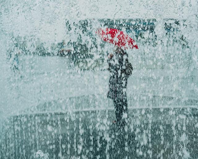 Red umbrella in the fountain