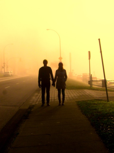 holding hands on a foggy day