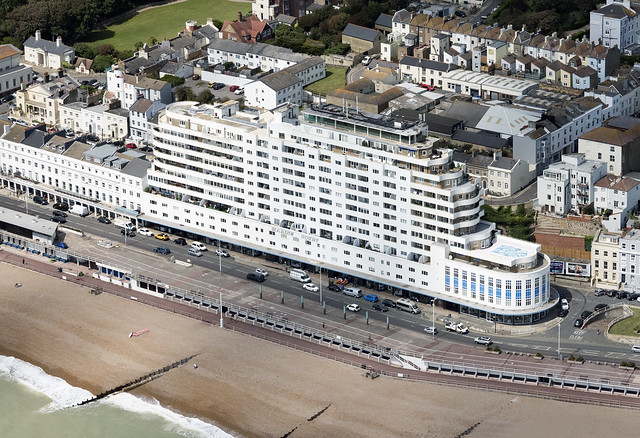 Inspired by the RMS Queen Mary, completed in 1938, it was the tallest block of flats in the UK - Marine Court in Hastings - East Sussex UK aerial image