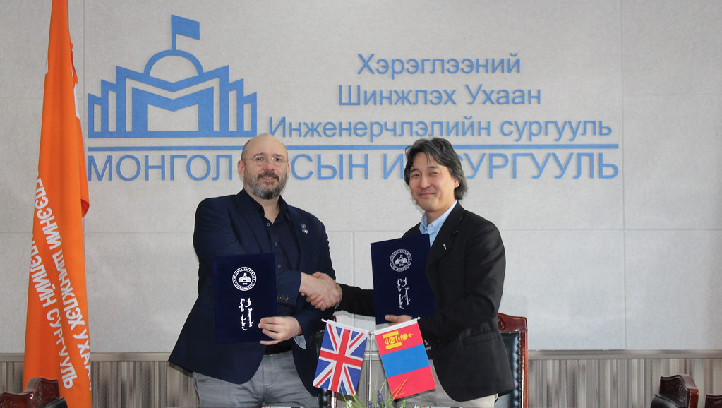 Andreas Kyprianou exchanging memorandum of understanding with National University of Mongolia