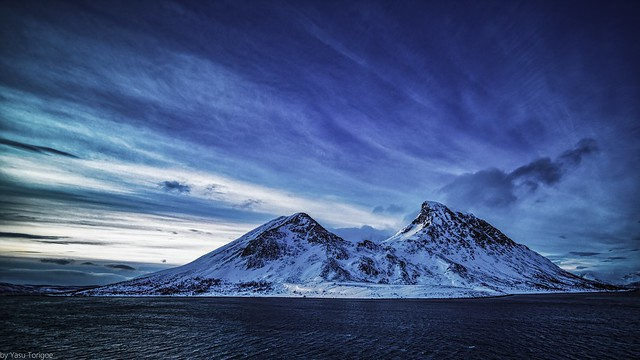 View of sunrise behind the mountain on Kågen island, Norway while sailing between Arnøya and Kågen Islands-19-2a