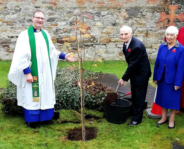 Mr Sam Morrow planting a rowan tree in the grounds of the Cathedral on Sunday, 3rd November to mark the launch of his new book on 13th November. Also included are Dean Kenneth Hall and Sam's wife, Marie.