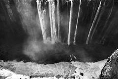 looking straight down as the water thunders and makes mini clouds. Fine art black & white of Victoria Falls or Mosi-oa-Tunya (The Smoke that Thunders), Zambezi River, Zambia, Zimbabwe, Africa