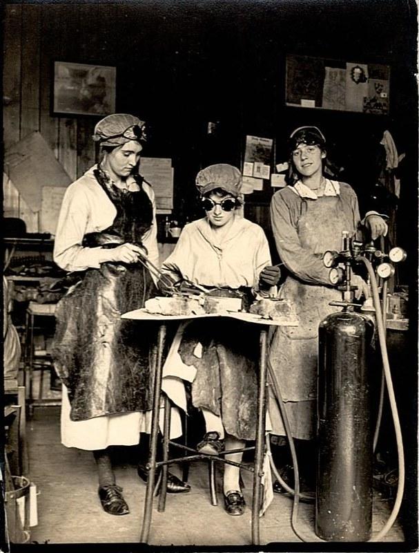 Unidentified women at work with oxyacetylene in a workshop