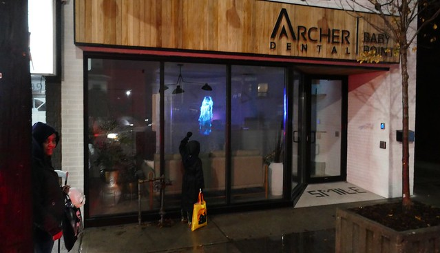 Ghosts in the window on Halloween evening at Archer Dental Baby Point