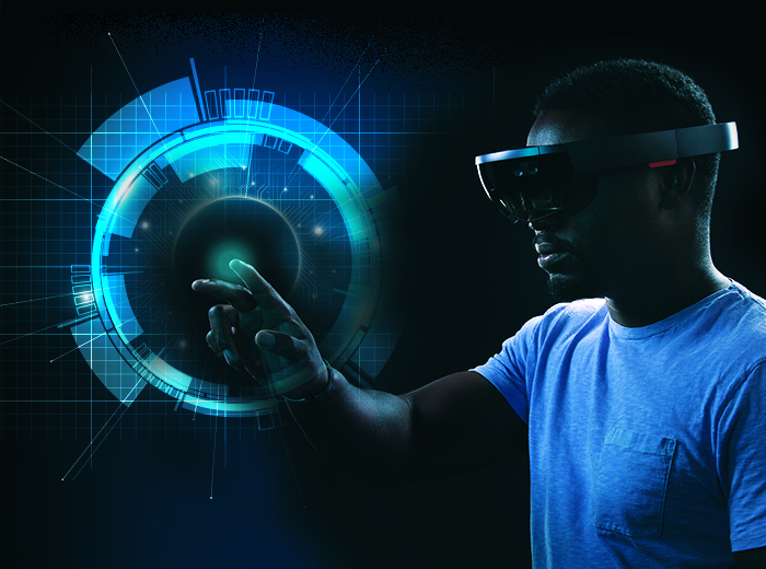 A man wearing a set of virtual reality goggles reaches to touch an image that shows up in the goggles' field of view.