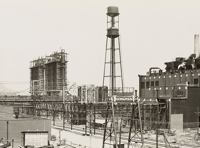A black and white photo of the West Virginia Ordnance Works factory; in the center of the picture is a tall water tower.