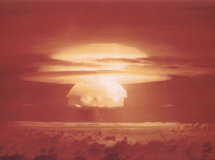 A bright, yellow-white mushroom cloud.
