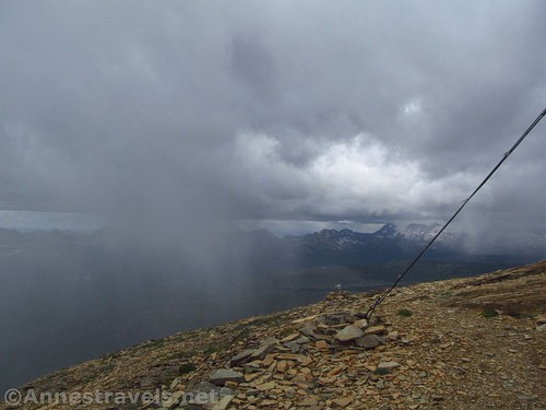 The storm approaches Swiftcurrent Mountain.  The guidewire is from the lookout. Glacier National Park, Montana