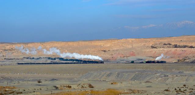 Coal train meets crane train
