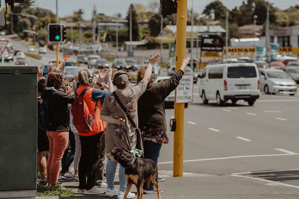 a walking group of people waving