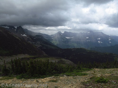 Storms blow in toward Logan Pass. Swiftcurrent Pass is quite visible below. Swiftcurrent Lookout Trail, Glacier National Park, Montana