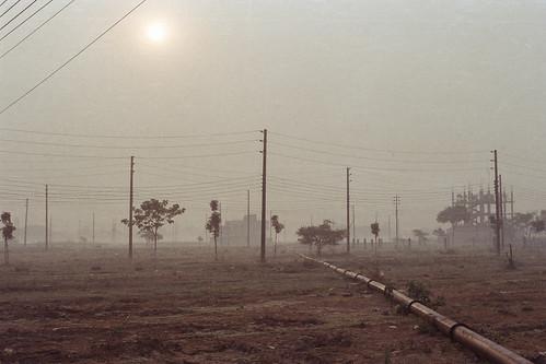 utilitylines suburbandhaka dhaka winter mist fujicolorc200 film bangladesh maze sunrise foggy nikonf100 fujifilm pacificimageprimefilm3650pro3 nikon ai50mmf14 fog analogphotography istillshootfilm analog aftabnagar