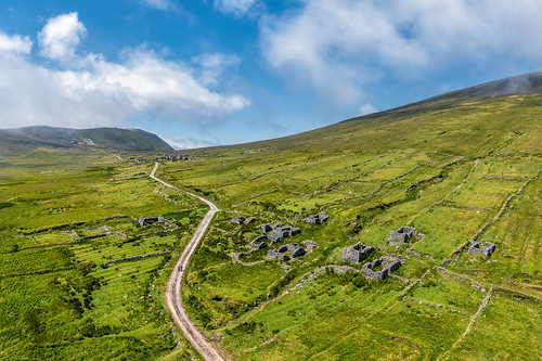 foot tours cliffs sea achil achill island dji phantom 4 four p4p pro drone aerial uav slievemore deserted famine village pano panoramic town abandoned ruin ghost summer landscape landmark way tourist attraction tourism tour historic history visit wild atlantic mayo ireland irish scenic gareth wray photography day vacation 2019 hill thatched stone lost grass clouds drive wildatlanticway sunny county postcard rocks green sound