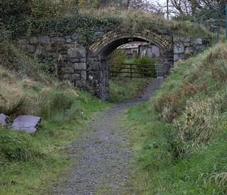 Bryngwyn branch railway line now a slate trail, a bridge just outside Rhostryfan station, typical yellow brick used by the NWNGR
