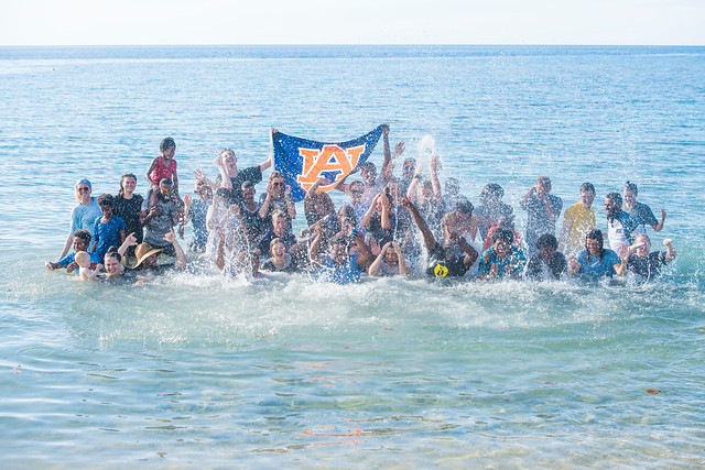 Students and Fijians play around in the Pacific Ocean