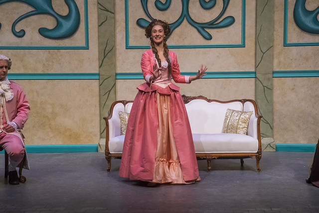 An actress performs on stage during a production of The Belle's Stratagem.