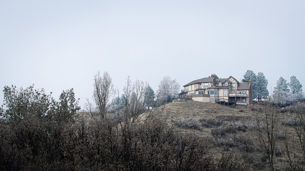 Large House on Hill in Fog by Michael Davies
