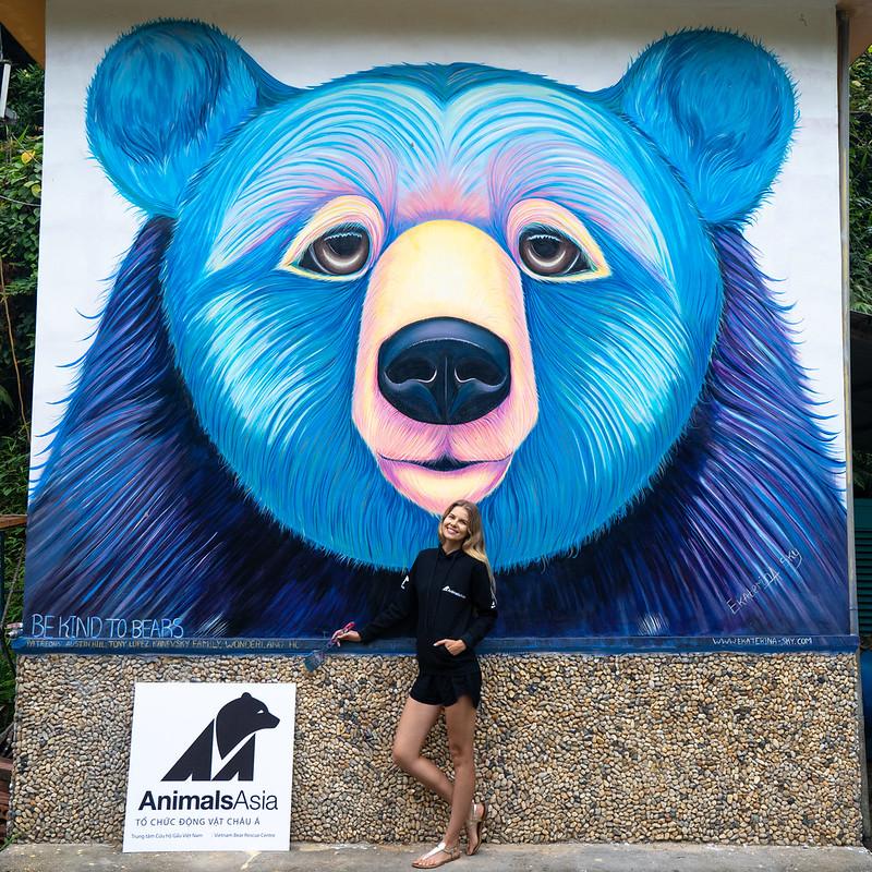 Ekaterina Sky besides her bear mural