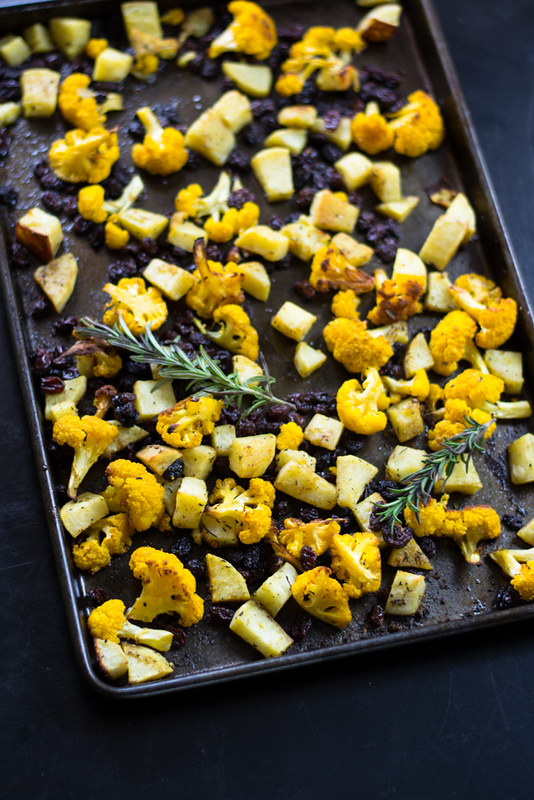 An easy and impressive side dish. Roasted cauliflower seasoned with fragrant spices of cumin and curry along with fresh rosemary and sweet raisins.