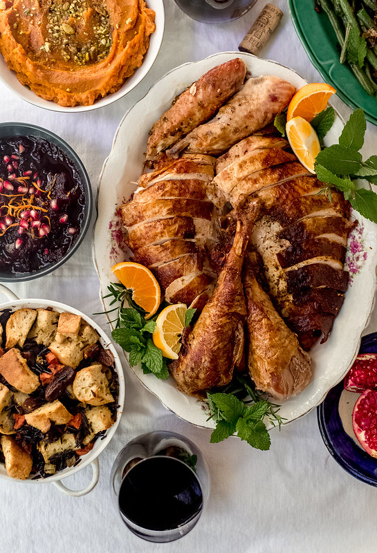 The ultimate Thanksgiving citrus and herb roast turkey, seasoned with loads of aromatic zaatar, citrus zest and fresh herbs and then slathered with butter making it juicy and flavorful.